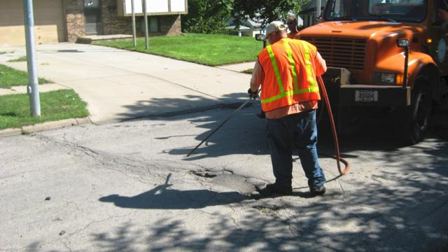 compressed-air-cleaning-pothole